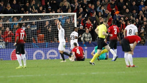 <p>               Valencia players celebrate after Manchester United's Phil Jones, center, scores an own goal during a Group H Champions League soccer match between Valencia and Manchester United at the Mestalla Stadium in Valencia, Spain, Wednesday, Dec. 12, 2018. (AP Photo/Alberto Saiz)             </p>