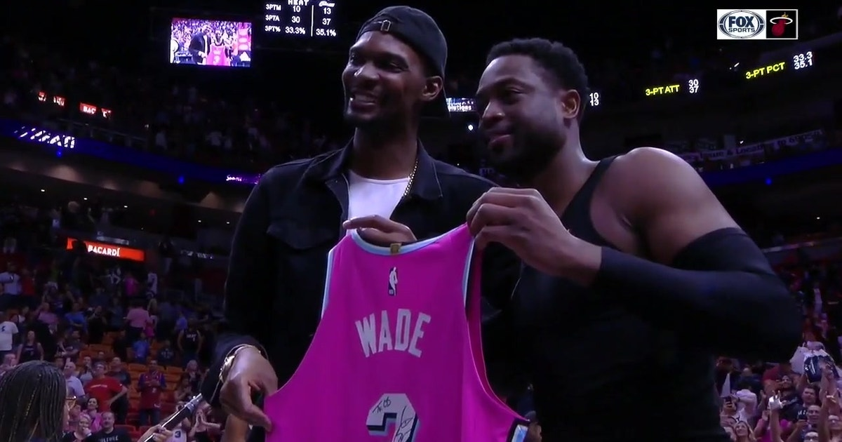 Classic Heat Moment  Dwyane Wade presents Chris Bosh with his Sunset Vice  jersey  5b80e4262