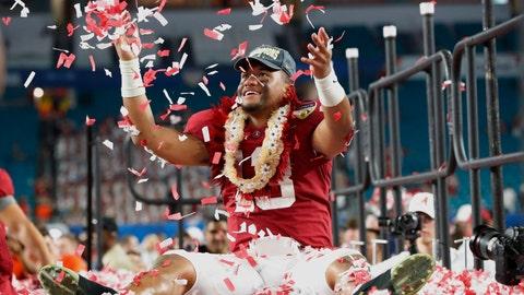 <p>               Alabama quarterback Tua Tagovailoa is throws confetti in the air after winning the Orange Bowl NCAA college football game against Oklahoma, Sunday, Dec. 30, 2018, in Miami Gardens, Fla. Alabama defeated Oklahoma 45-34. (AP Photo/Wilfredo Lee)             </p>