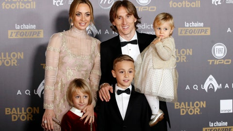 "<p>               Real Madrid's Luka Modric arrives with his family for the Golden Ball, ""Ballon d'Or"" award ceremony at the Grand Palais in Paris, France, Monday, Dec.3, 2018. Awarded every year by France Football magazine since Stanley Matthews won it in 1956, the Ballon d'Or, Golden Ball for the best player of the year will be given to both a woman and a man. (AP Photo/Christophe Ena)             </p>"