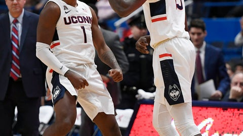 <p>               Connecticut's Christian Vital (1) and Connecticut's Sidney Wilson (15) react during the first half of an NCAA college basketball game against Drexel, Tuesday, Dec. 18, 2018, in Hartford, Conn. (AP Photo/Jessica Hill)             </p>