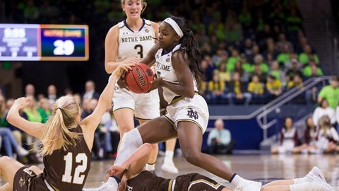<p>               Notre Dame's Jackie Young (5) tries to hang onto the ball as she falls over Lehigh's Gena Grundhoffer (12) and Camryn Buhr (15) in front of Notre Dame's Marina Mabrey (3) during the first half of an NCAA college basketball game Sunday, Dec. 30, 2018, in South Bend, Ind. (AP Photo/Robert Franklin)             </p>