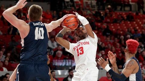 <p>               Utah State forward Quinn Taylor (10) blocks the shot attempt by Houston guard Dejon Jarreau (13) as Utah State guard John Knight III, right, looks on during the first half of an NCAA college basketball game Thursday, Dec. 20, 2018, in Houston. (AP Photo/Michael Wyke)             </p>