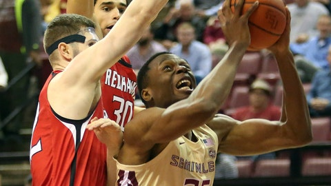 <p>               Florida State's Mfiondu Kabengele (25) works under the basket against Southeast Missouri's Mark Laros, left, and Gabe McGlothan in the first half of an NCAA college basketball game Monday, Dec.17, 2018, in Tallahassee, Fla. (AP Photo/Steve Cannon)             </p>