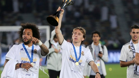 <p>               Real Madrid's Luka Modric holds the trophy after winning the Club World Cup final soccer match between Real Madrid and Al Ain at Zayed Sport City in Abu Dhabi, United Arab Emirates, Saturday, Dec. 22, 2018. Real Madrid won 4-1. (AP Photo/Kamran Jebreili)             </p>