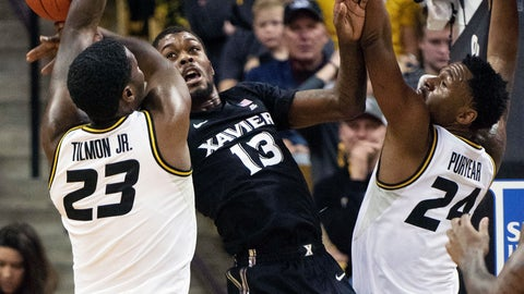 <p>               Xavier's Naji Marshall, center, bobbles a pass between Missouri's Jeremiah Tilmon, left, and Kevin Puryear, right, during the first half of an NCAA college basketball game Tuesday, Dec. 18, 2018, in Columbia, Mo. (AP Photo/L.G. Patterson)             </p>