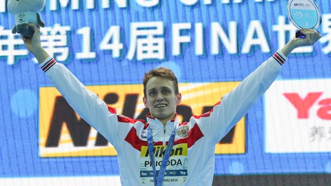 <p>               Gold medalist and world record holder Russia's Kirill Prigoda poses during ceremonies at the men's 200m breaststroke during the 14th FINA World Swimming Championships in Hangzhou in eastern China's Zhejiang Province on Thursday, Dec. 13, 2018. Prigoda broke the world record with a time of 2:00.16 (AP Photo/Ng Han Guan)             </p>