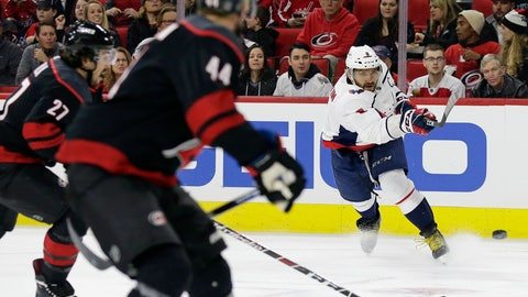 <p>               Washington Capitals' Alex Ovechkin (8), of Russia, shoots and scores while Carolina Hurricanes' Calvin de Haan (44) and Justin Faulk (27) defend at left during the first period of an NHL hockey game in Raleigh, N.C., Friday, Dec. 14, 2018. (AP Photo/Gerry Broome)             </p>