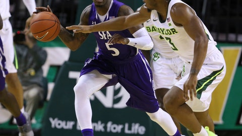 <p>               Stephen F. Austin guard Shannon Bogues, left, heads up court past Baylor guard King McClure, right, in the first half of an NCAA college basketball game, Tuesday, Dec. 18, 2018, in Waco, Texas. (Rod Aydelotte/Waco Tribune Herald, via AP)             </p>
