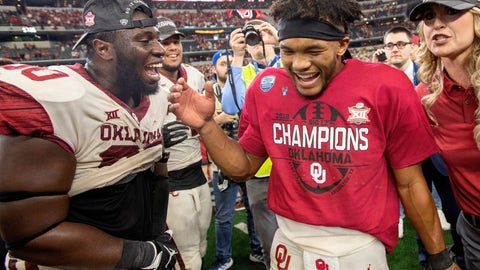 <p>               Oklahoma quarterback Kyler Murray, right, celebrates with teammate Neville Gallimore after beating Texas 39-27 in the Big 12 Conference championship NCAA college football game on Saturday, Dec. 1, 2018, in Arlington, Texas. (AP Photo/Jeffrey McWhorter)             </p>