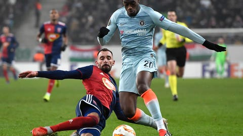 <p>               Vidi's Attila Fiola, left, in action against Chelsea's Callum Hudson-Odoi during the UEFA Europa League Group L soccer match between Vidi FC and Chelsea in Groupama Arena in Budapest, Hungary, Thursday, Dec. 13, 2018. (Tibor Illyes/MTI via AP)             </p>
