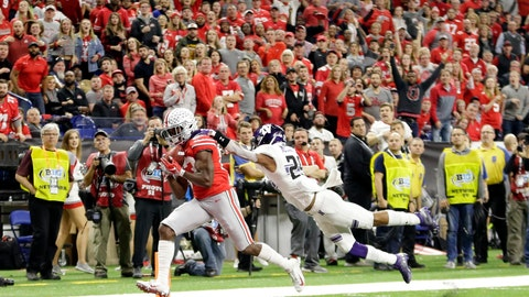<p>               Ohio State wide receiver Terry McLaurin, left, catches a touchdown pass as Northwestern defensive back Greg Newsome II defends during the first half of the Big Ten championship NCAA college football game, Saturday, Dec. 1, 2018, in Indianapolis. (AP Photo/AJ Mast)             </p>