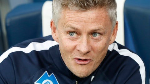 <p>               FILE - In this Thursday, Aug. 23, 2018 file photo, Molde's head coach Ole Gunnar Solskjaer watches his team prior to the Europa League play-off round, first leg soccer match between Zenit and Molde at Petrovsky stadium in St. Petersburg, Russia. Manchester United announced Wednesday Dec. 19, 2018, they have hired Ole Gunnar Solskjaer as its manager until the end of the season, bringing the Norwegian back to the club 20 seasons after he scored its winning goal in the Champions League final. (AP Photo/Dmitri Lovetsky, File)             </p>