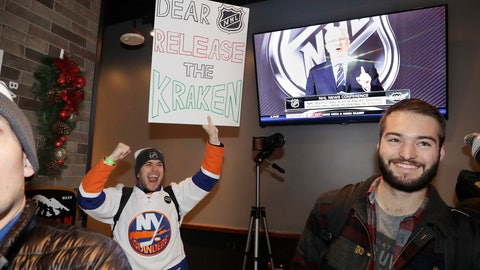 "<p>               Max Rubin cheers and holds a sign in favor of the team name ""Kraken"" following the announcement of a new NHL hockey team in Seattle, at a celebratory party Tuesday, Dec. 4, 2018, in Seattle.  (AP Photo/Elaine Thompson)             </p>"