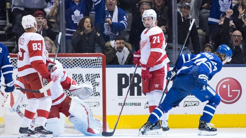 <p>               Toronto Maple Leafs right wing Kasperi Kapanen, right, turns after scoring his team's opening goal as Detroit Red Dylan Larkin (71) looks on during first period NHL hockey action in Toronto, Sunday, Dec. 23, 2018. (Chris Young/The Canadian Press via AP)             </p>