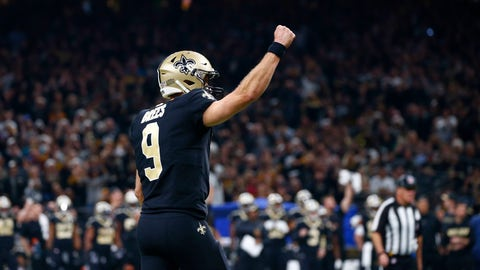 <p>               New Orleans Saints quarterback Drew Brees (9) celebrates a touchdown by running back Alvin Kamara, not pictured, in the first half of an NFL football game in New Orleans, Sunday, Dec. 23, 2018. The Saints won 31-28, clinching the top seed for the NFC and home field advantage for the playoffs. (AP Photo/Butch Dill)             </p>