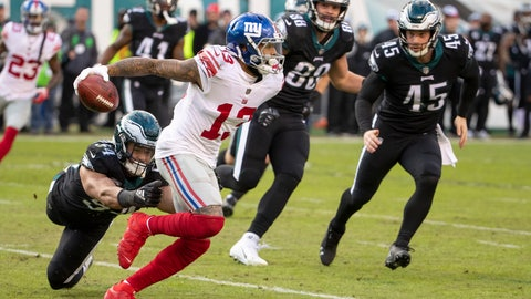 <p>               FILE - In this Sunday, Nov. 25, 2018 file photo, New York Giants wide receiver Odell Beckham Jr. returns the punt against Philadelphia Eagles outside linebacker Kamu Grugier-Hill during the second half of the NFL football game in Philadelphia. New York Giants receiver Odell Beckham Jr. has had his injured quad examined by a specialist and his status for Sunday's game against the Tennessee Titans is uncertain. Beckham was hurt when he was leg whipped on the final play of the Giants' loss to the Eagles in Philadelphia on Nov. 25.  (AP Photo/Chris Szagola, File)             </p>