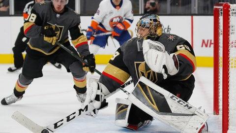 <p>               Vegas Golden Knights goaltender Marc-Andre Fleury (29) blocks a shot by the New York Islanders during the third period of an NHL hockey game Thursday, Dec. 20, 2018, in Las Vegas. (AP Photo/John Locher)             </p>
