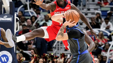 <p>               New Orleans Pelicans guard Jrue Holiday (11) guards Dallas Mavericks forward Luka Doncic (77) in the first half of an NBA basketball game in New Orleans, Wednesday, Dec. 5, 2018. (AP Photo/Scott Threlkeld)             </p>