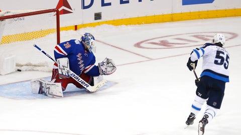 <p>               Winnipeg Jets center Mark Scheifele (55) scores the winning goal against New York Rangers goaltender Henrik Lundqvist (30) during a shoot out of an NHL hockey game, Sunday, Dec. 2, 2018, in New York. The Jets won 4-0. (AP Photo/Noah K. Murray)             </p>
