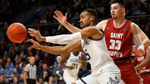 <p>               Villanova guard Phil Booth (5) passes the ball away from Saint Joseph's forward Taylor Funk (33) during the first half of an NCAA college basketball game, Saturday, Dec. 8, 2018, in Villanova, Pa. (AP Photo/Laurence Kesterson)             </p>