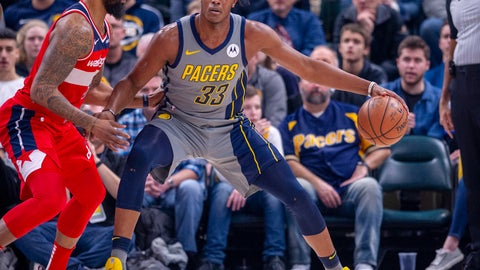 <p>               Indiana Pacers center Myles Turner (33) works the ball toward the basket against the defense of Washington Wizards forward Markieff Morris (5) during an NBA basketball game, Sunday, Dec. 23, 2018, in Indianapolis. (AP Photo/Doug McSchooler)             </p>