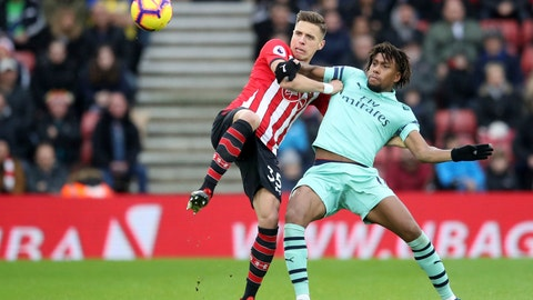 <p>               Arsenal's Alex Iwobi, left, and Southampton's Jan Bednarek in action during their English Premier League soccer match at St Mary's Stadium in Southampton, England, Sunday Dec. 16, 2018. (Adam Davy/PA via AP)             </p>