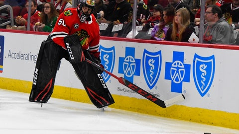 <p>               Chicago Blackhawks goaltender Corey Crawford (50) passes the puck during the first period of an NHL hockey game against the San Jose Sharks Sunday Dec. 16, 2018, in Chicago. Crawford left the game with 1:30 left in the first period after the back of his head struck the right post during a goalmouth pile-up. (AP Photo/Matt Marton)             </p>