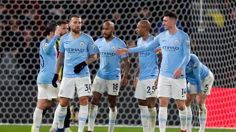 <p>               Manchester City players celebrate after winning the English Premier League soccer match between Watford and Manchester City at Vicarage Road stadium in Watford, England, Tuesday, Dec. 4, 2018. Manchester City won 2-1. (AP Photo/Frank Augstein)             </p>