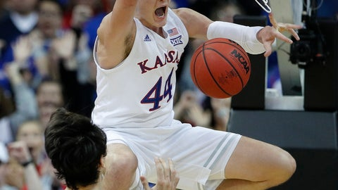 <p>               Kansas' Mitch Lightfoot (44) celebrates after getting past New Mexico State's Ivan Aurrecoechea (15) for a dunk during the second half of an NCAA college basketball game Saturday, Dec. 8, 2018, in Kansas City, Mo. Kansas won 63-60. (AP Photo/Charlie Riedel)             </p>