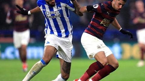 <p>               Huddersfield Town's Philip Billing, left,and Newcastle United's Ayoze Perez battle for the ball during the English Premier League soccer match between Huddersfield Town and Newcastle at the John Smith's stadium, Huddersfield, England. Saturday Dec. 15, 2018. (Mike Egerton/PA via AP)             </p>