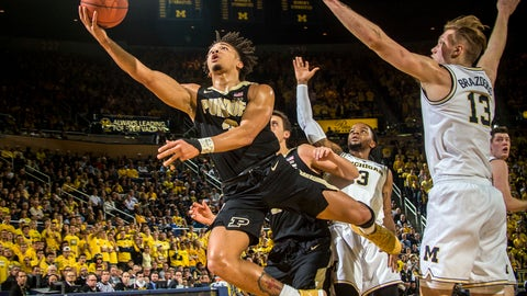 <p>               Purdue guard Carsen Edwards, left, attempts a layup while defended by Michigan guard Zavier Simpson (3) and forward Ignas Brazdeikis (13) in the first half of an NCAA college basketball game against Michigan at Crisler Center in Ann Arbor, Mich., Saturday, Dec. 1, 2018. (AP Photo/Tony Ding)             </p>