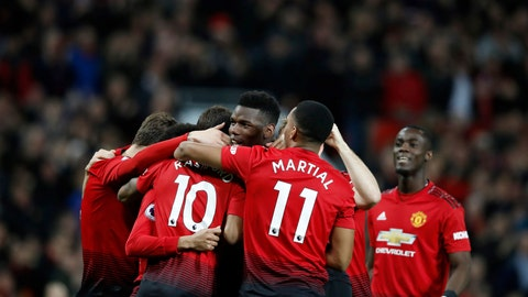 <p>               Manchester United's Paul Pogba, centre, celebrates with teammates after scoring his side's first goal of the game against Bournemouth, during their English Premier League soccer match at Old Trafford in Manchester, England, Sunday Dec. 30, 2018. (Martin Rickett/PA via AP)             </p>
