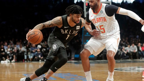 <p>               Brooklyn Nets' D'Angelo Russell (1) drives past Atlanta Hawks' Vince Carter (15) during the second half of an NBA basketball game Sunday, Dec. 16, 2018, in New York. The Nets won 144-127. (AP Photo/Frank Franklin II)             </p>