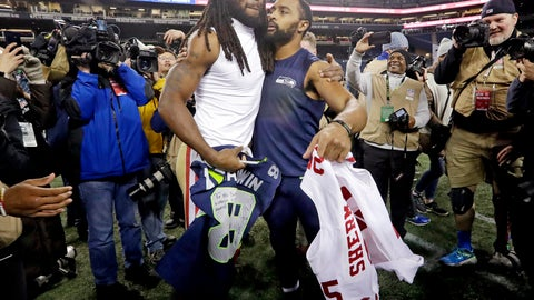 <p>               Seattle Seahawks wide receiver Doug Baldwin, right, hugs San Francisco 49ers cornerback Richard Sherman, left, after they traded jerseys following an NFL football game, Sunday, Dec. 2, 2018, in Seattle. The Seahawks won 43-16. (AP Photo/Elaine Thompson)             </p>