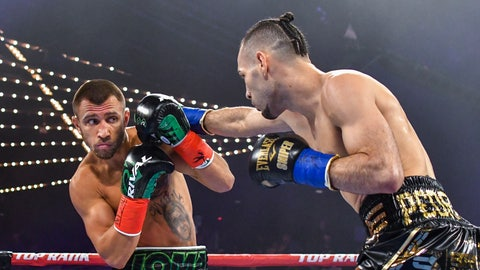 <p>               Vasiliy Lomachenko moves away from punch from Jose Pedraza in the WBO lightweight title boxing match at Madison Square Garden, Saturday, Dec. 8, 2018, in New York. (AP Photo/Howard Simmons)             </p>