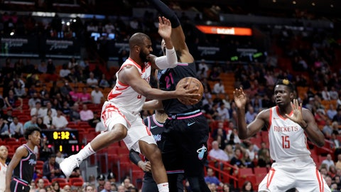 <p>               Houston Rockets guard Chris Paul, left, passes to center Clint Capela (15) as Miami Heat center Hassan Whiteside defends during the first half of an NBA basketball game, Thursday, Dec. 20, 2018, in Miami. (AP Photo/Lynne Sladky)             </p>