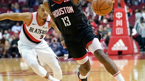 <p>               Houston Rockets' James Harden (13) drives past Portland Trail Blazers' CJ McCollum (3) during the first half of an NBA basketball game Tuesday, Dec. 11, 2018, in Houston. (AP Photo/David J. Phillip)             </p>
