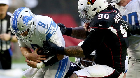 <p>               Detroit Lions quarterback Matthew Stafford (9) is hit by Arizona Cardinals defensive tackle Robert Nkemdiche (90) during the first half of NFL football game, Sunday, Dec. 9, 2018, in Glendale, Ariz. (AP Photo/Ross D. Franklin)             </p>