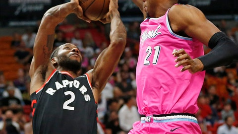 <p>               Miami Heat center Hassan Whiteside (21) defends against Toronto Raptors forward Kawhi Leonard (2) as he shoots the ball during the first half of an NBA basketball game, Wednesday, Dec. 26, 2018, in Miami. (AP Photo/Joel Auerbach)             </p>