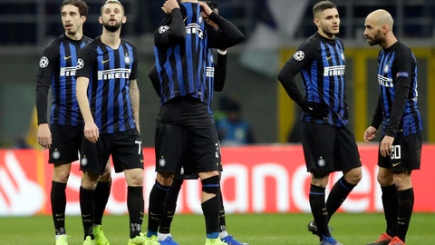 <p>               Inter's players react at the end of the Champions League, Group B soccer match between Inter Milan and PSV Eindhoven, at the San Siro stadium in Milan, Italy, Tuesday, Dec. 11, 2018. The game ended 1-1. (AP Photo/Luca Bruno)             </p>