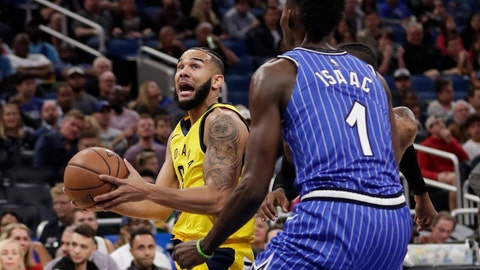 <p>               Indiana Pacers' Cory Joseph, left, looks for a shot as Orlando Magic's Jonathan Isaac (1) defends during the first half of an NBA basketball game Friday, Dec. 7, 2018, in Orlando, Fla. (AP Photo/John Raoux)             </p>