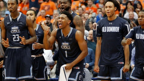 <p>               Old Dominion's Jason Wade, center, cheers with teammates on the bench in the final seconds of an NCAA college basketball game against Syracuse in Syracuse, N.Y., Saturday, Dec. 15, 2018. Old Dominion won 68-62. (AP Photo/Nick Lisi)             </p>