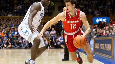 <p>               Hartford's Jason Dunne (12) drives against Duke's Zion Williamson (1) during the first half of an NCAA college basketball game in Durham, N.C., Wednesday, Dec. 5, 2018. (AP Photo/Ben McKeown)             </p>