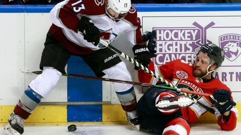 <p>               Colorado Avalanche center Alexander Kerfoot (13) and Florida Panthers defenseman Aaron Ekblad battle for the puck during the third period of an NHL hockey game, Thursday, Dec. 6, 2018 in Sunrise, Fla. (AP Photo/Wilfredo Lee)             </p>