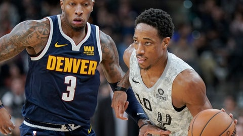 <p>               San Antonio Spurs' DeMar DeRozan (10) drives around Denver Nuggets' Torrey Craig during the second half of an NBA basketball game Wednesday, Dec. 26, 2018, in San Antonio. San Antonio won 111-103. (AP Photo/Darren Abate)             </p>