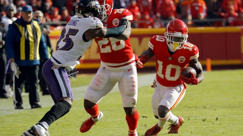 <p>               Kansas City Chiefs wide receiver Tyreek Hill (10) carries the ball as running back Damien Williams (26) blocks Baltimore Ravens cornerback Tavon Young (25) during the first half of an NFL football game in Kansas City, Mo., Sunday, Dec. 9, 2018. (AP Photo/Charlie Riedel)             </p>