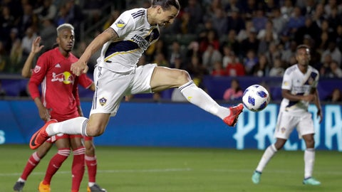 <p>               FILE - In this April 28, 2018, file photo, LA Galaxy forward Zlatan Ibrahimovic kicks the ball into the goal during the second half of an MLS soccer match against the New York Red Bulls, in Carson, Calif. The goal was later disallowed. Zlatan Ibrahimovic is returning to the Los Angeles Galaxy. A person with knowledge of the deal confirms the 37-year-old striker will play next season for the Galaxy. The person spoke on the condition of anonymity because the team had not yet formally announced it. (AP Photo/Chris Carlson, File)             </p>