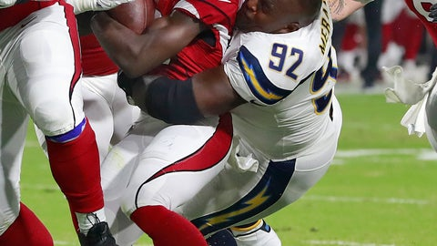 <p>               FILE - In this Aug. 11, 2018 file photo Los Angeles Chargers defensive tackle Brandon Mebane (92) loses his helmet as he tackles Arizona Cardinals running back Chase Edmonds (29) during the first half of a preseason NFL football game in Glendale, Ariz. Mebane has returned to the team after missing two games while caring for his newborn daughter. (AP Photo/Rick Scuteri)             </p>