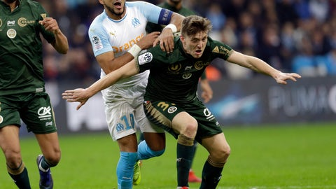 <p>               Marseille's Dimitri Payet, left, challenges for the ball with Reims'Thomas Foket, during the League One soccer match between Marseille and Reims at the Velodrome stadium, in Marseille, southern France, Sunday, Dec. 2, 2018. (AP Photo/Claude Paris)             </p>